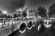 canvas print picture - Beautiful view of the famous UNESCO world heritage canals of Amsterdam, the Netherlands, in black and white. Keizersgracht (Emperors canal)