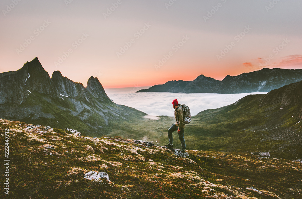 Fototapety, obrazy: Man backpacker hiking in mountains alone  outdoor active lifestyle travel adventure vacations sunset Norway landscape