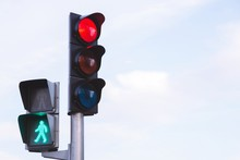 Traffic Lights With Red Light Stop Car On The Road. And Green Light Safe To Move  Pedestrian Traffic Lights Walk Across Crosswalk Against Beautiful Blue Sky Background. Soft Focus.