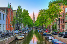 Beautiful Groenburgwal Canal In Amsterdam With The Soutern Church (Zuiderkerk) At Sunset In Summer