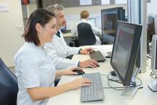 Medical Secretaries Browsing The Files