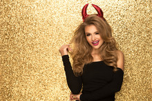 Sexy Blonde Woman Like A Devil Over Gold Background