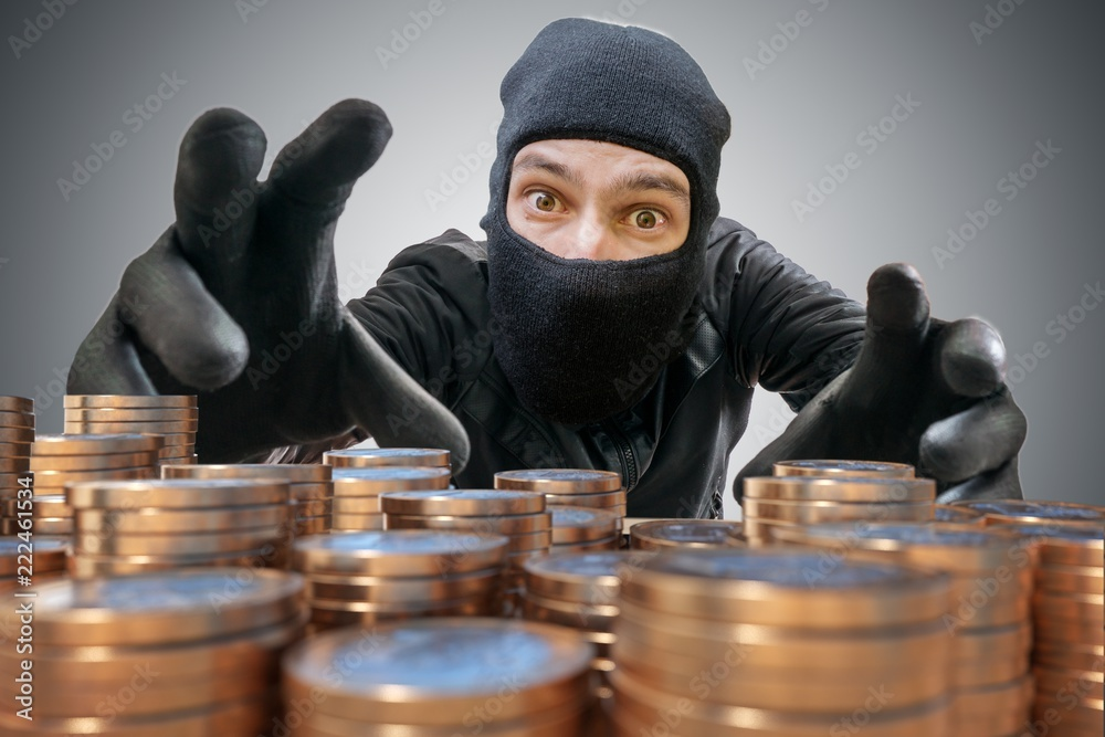 Fototapeta Robber or thief is trying to grab and steal coins.