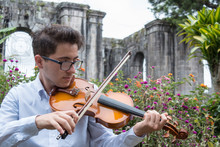 Portrait Of Young Violinist Outside The Castle