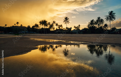 Montage in der Fensternische Tropical strand Sandy beach and palm trees on the background of the colourful sunset sky on a tropical island