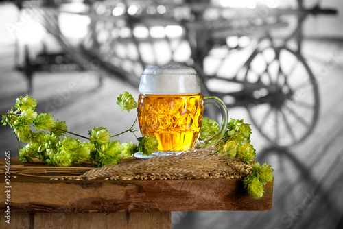 Poster Bier / Cider Still life with beer,hops and barley in the old barn