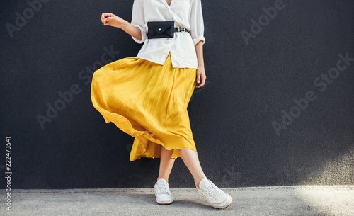 Horizontal cropped image of stylish slim woman in beautiful yellow skirt Wallpaper Mural
