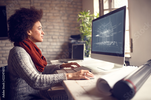 Female works on architect project at her workplace Canvas Print