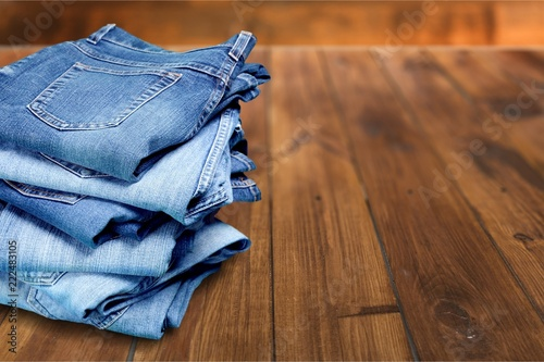 Tela  Stack of jeans isolated on white background