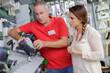 hardwarer store worker with craftswoman buyer