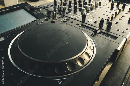 DJ turntable deck mixer close up, sound equipment, audio control panel for party Wallpaper Mural