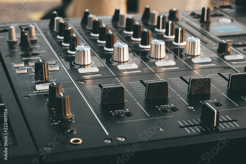 Photo DJ turntable deck mixer close up, sound equipment, audio control panel for party