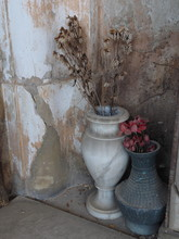 Cemetery, Vase With Dried Flowers In Front Of A Gravestone.