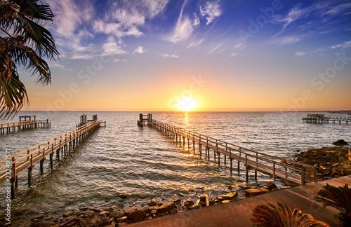 Fototapeta Long wooden fishing docks stretch out into Galveston Bay, Texas