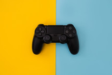 Video Games Gaming Controller Isolated On Yellow Blue Background