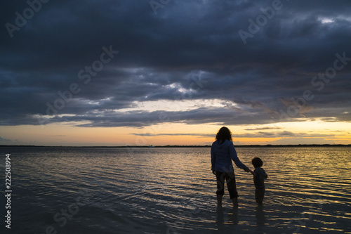 Spoed Foto op Canvas Zee zonsondergang Mother and son playing in sea at sunset, Cancun, Quintana Roo, Mexico