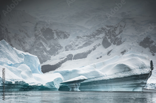 Iceberg against coastline, Paradise Bay, Antarctica