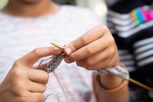 Close Up Of Girl Knitting Yarn