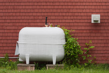 Heating Fuel Oil Tank Beside Exterior Wall.
