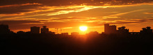 Panoramic View Of Cityscape With Silhouette Of City Skyline Against Setting Sun. Minsk, Belarus