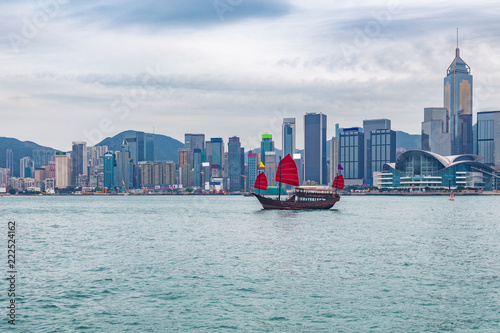 Hong Kong Asia travel landscape background of Chinese city with tourist junk boat.