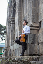 Portrait Of Violinist In Castle