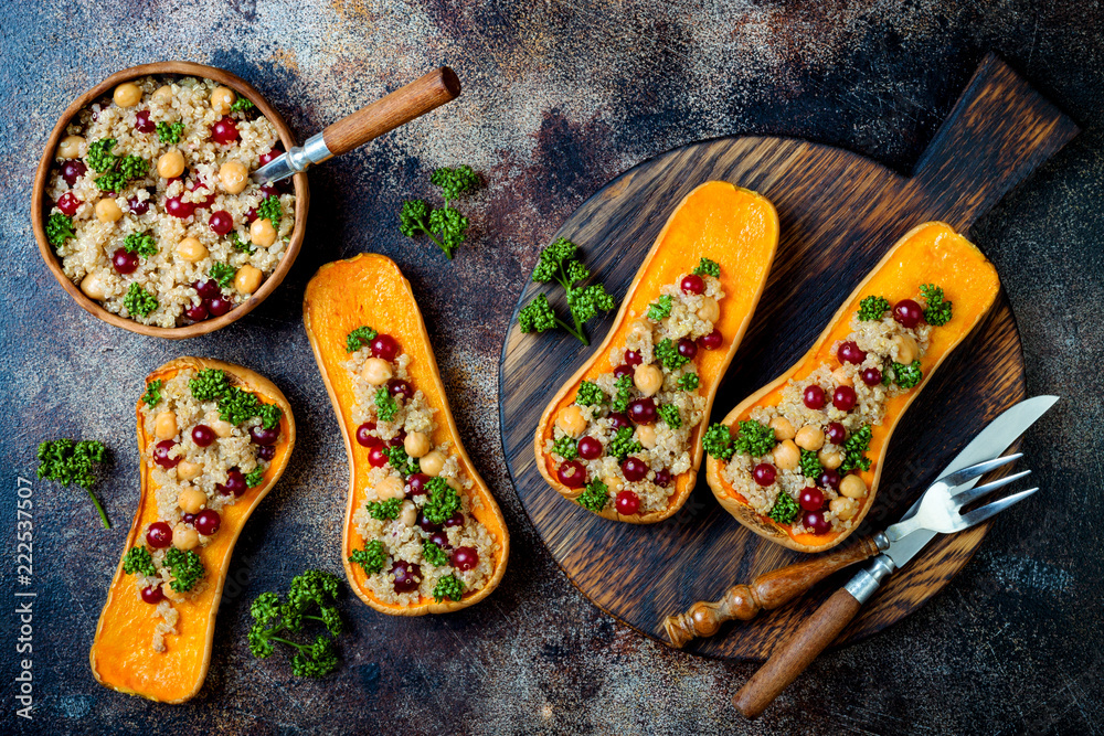 Fototapety, obrazy: Stuffed butternut squash with chickpeas, cranberries, quinoa cooked in nutmeg, cloves, cinnamon. Thanksgiving dinner recipe. Vegan healthy seasonal fall or autumn food