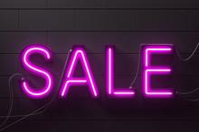 Neon Purple Sale Sign On Black Brick Wall