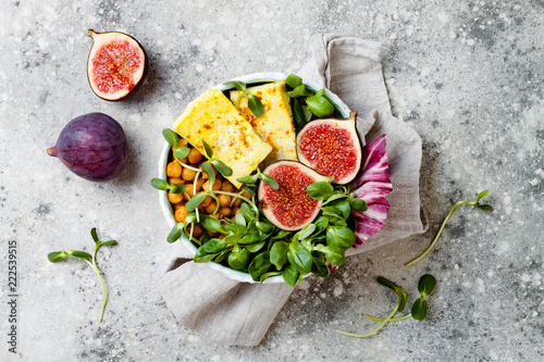 Fotografie, Obraz  Vegan, detox Buddha bowl recipe with turmeric roasted tofu, figs, chickpeas and greens