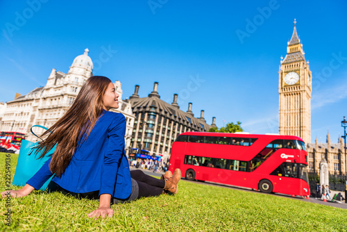 Tuinposter Londen rode bus Happy tourist woman relaxing in London city at Westminster Big ben and red bus. Europe destination travel lifestyl.e