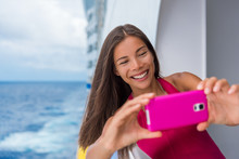 Selfie Photo Cruise Woman Taking Travel Picture On Caribbean Holiday Vacation. Asian Girl Smiling Happy Taking A Self-portrait On Ship Balcony Deck.
