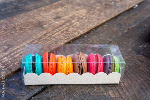 Staande foto Macarons Beautiful box of colourful macarons on a wooden bench