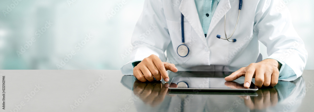 Fototapety, obrazy: Doctor with tablet computer at hospital office.