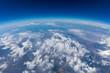 Leinwandbild Motiv Curvature of planet earth. Aerial shot. Blue sky and clouds