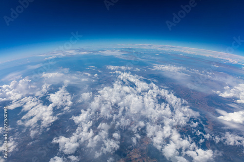 Curvature of planet earth. Aerial shot. Blue sky and clouds - 222580994