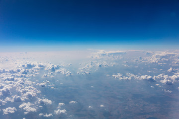 Cloudscape background. View out of an airplane window.