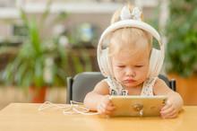 Little Girl Watching Cartoons ...