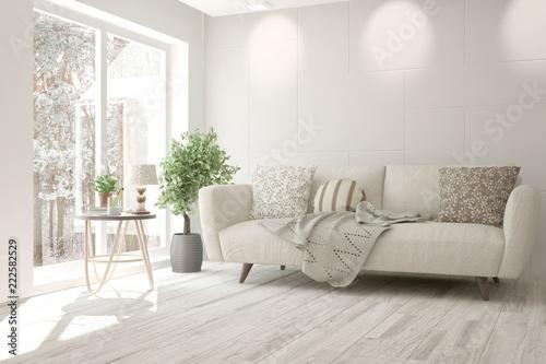 Fototapeta White room with sofa and winter landscape in window. Scandinavian interior design. 3D illustration obraz na płótnie