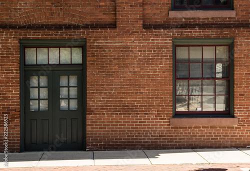 Vászonkép Door and Window in Brick Wall