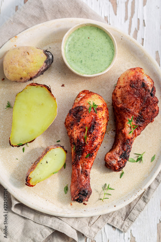 Spicy roasted chicken served with fresh sauce