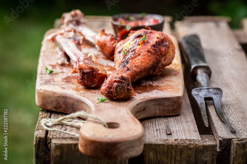 Crispy roasted chicken in green summer garden