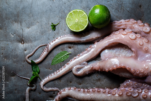 Preparing fresh octopus with lime and mint leaves