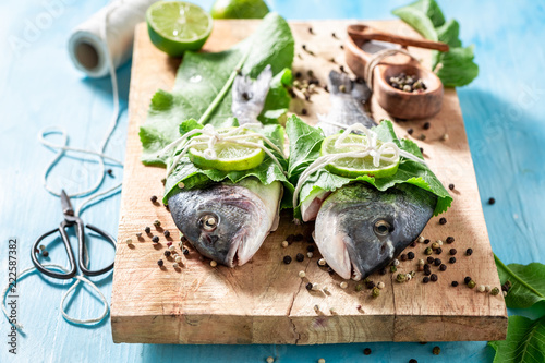 Freshly caught whole fish with horseradish and lemon
