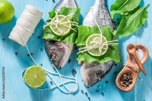 Preparing whole fish with lime and horseradish leaves