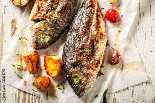 Tasty potatoes and seabream with cherry tomatoes and thyme