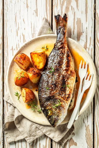 Fresh potatoes and seabream with cherry tomatoes and thyme