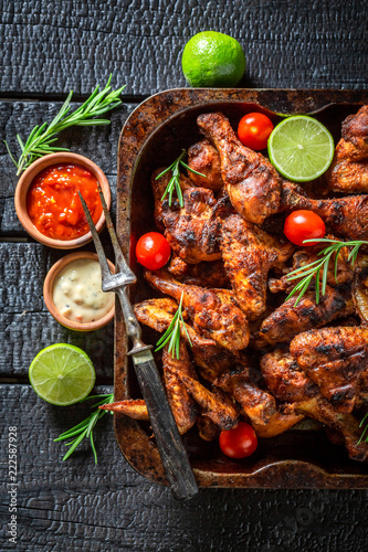 Spicy grilled chicken leg with rosemary and spices