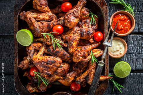 Spicy roasted chicken wings with rosemary and spices