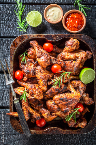 Tasty grilled chicken leg with rosemary and spices