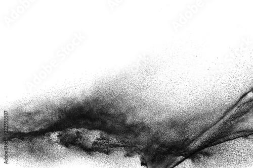 Fototapeta Black particles splattered on white background. Black powder dust splashing. obraz